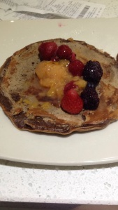 Chocolate protein pancake with stewed plums and frozen berries.